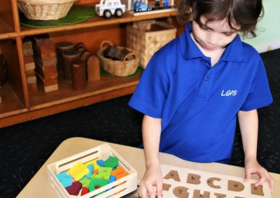 student playing with puzzle letters
