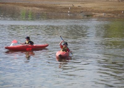 Two boys learning to kayak on Aquatics camp